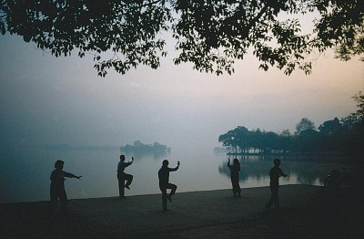 Tai Chi Silhouette by lake
